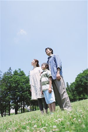Japanese Family Standing In a Park Stock Photo - Rights-Managed, Code: 859-03755334