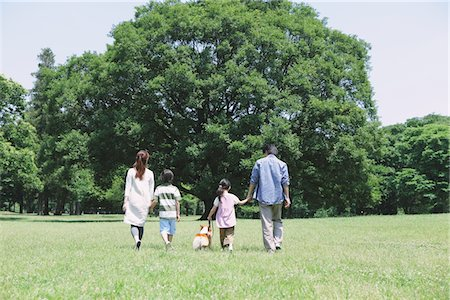 Family In a Park With Pet Stock Photo - Rights-Managed, Code: 859-03755350