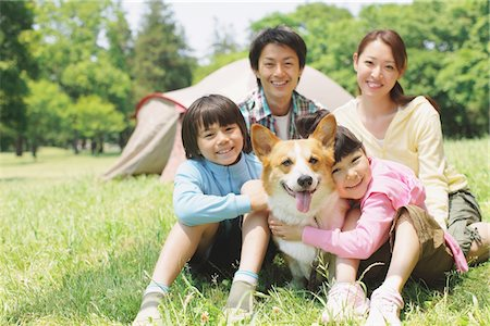 Japanese Family Having Fun In a Field With Pet Stock Photo - Rights-Managed, Code: 859-03755388