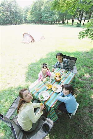 Family Having Food In a Field Stock Photo - Rights-Managed, Code: 859-03755405
