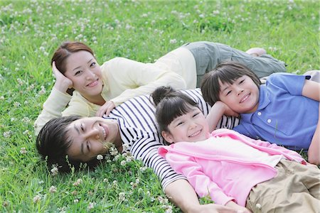 Japanese Family Resting In a Park Stock Photo - Rights-Managed, Code: 859-03755465