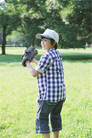 preteen  smile  one  alone - Boy Standing In a Park In Ready Position Stock Photo - Rights-Managed, Code: 859-03755472