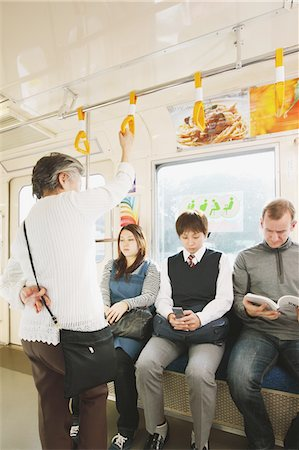 Passengers traveling on a train Stock Photo - Rights-Managed, Code: 859-03755495