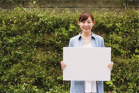 poster - Young Woman Holding Whiteboard Stock Photo - Rights-Managed, Code: 859-03779848