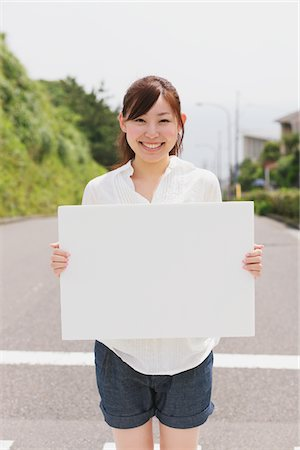 poster - Young Woman Holding Whiteboard Stock Photo - Rights-Managed, Code: 859-03779907