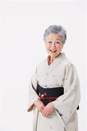 Senior Woman Wearing Kimono Laughing Stock Photo - Rights-Managed, Code: 859-03779953