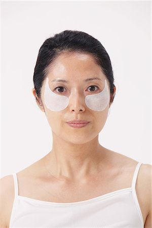 facial - Woman With A Smear Of Beauty Cream On Face Stock Photo - Rights-Managed, Code: 859-03779975
