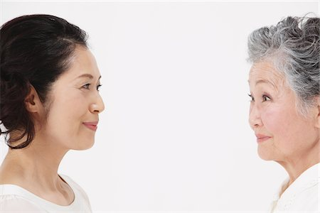 Mother And Adult Daughter Face To Face Stock Photo - Rights-Managed, Code: 859-03779995