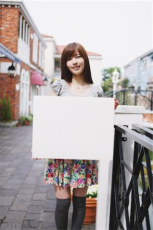 poster - Young Girl Holding Whiteboard Stock Photo - Rights-Managed, Code: 859-03780088