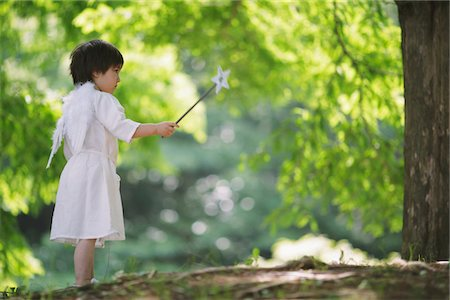 Angel Boy Standing Holding Magic Wand Stock Photo - Rights-Managed, Code: 859-03781906