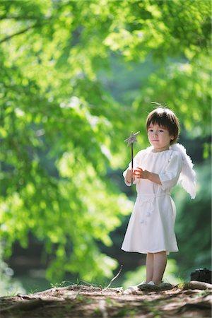 Boy Holding Magic Wand Stock Photo - Rights-Managed, Code: 859-03781907