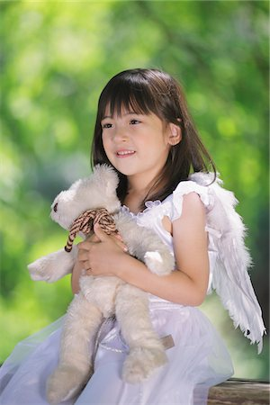 Girl Holding Teddy Bear Stock Photo - Rights-Managed, Code: 859-03781922