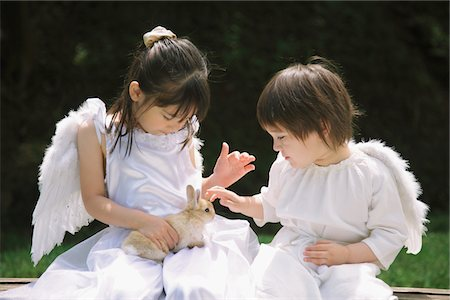 Children Playing with Rabbit Stock Photo - Rights-Managed, Code: 859-03781936