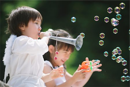 Children Playing Trumpet and Blowing Bubbles Stock Photo - Rights-Managed, Code: 859-03781947