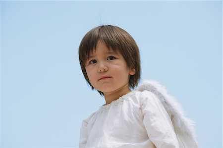 Boy Dressed-up as an Angel Stock Photo - Rights-Managed, Code: 859-03781943