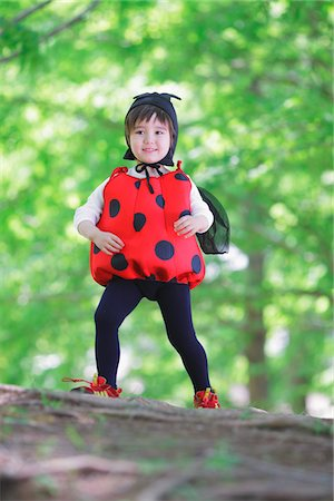 Boy Standing on Log Dressed as Ladybird Stock Photo - Rights-Managed, Code: 859-03781950