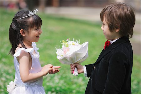 Boy Offering  Flowers to Girl Stock Photo - Rights-Managed, Code: 859-03781962