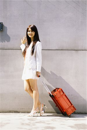 Young Woman Standing with Luggage Stock Photo - Rights-Managed, Code: 859-03782120