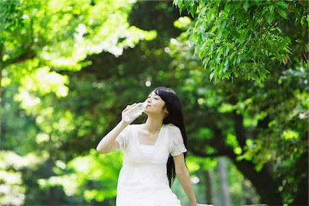 Young Woman Drinking Water from Bottle Stock Photo - Rights-Managed, Code: 859-03782195