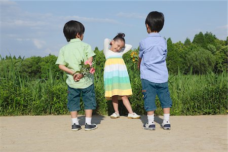 Boys Offering Flowers to Girl Stock Photo - Rights-Managed, Code: 859-03782445