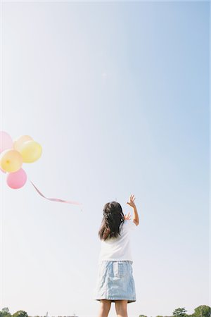 release - Girl releasing Bunch of Balloons Stock Photo - Rights-Managed, Code: 859-03805802