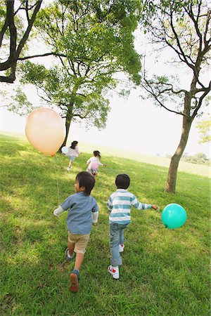 Children Having Fun in Park Stock Photo - Rights-Managed, Code: 859-03805851