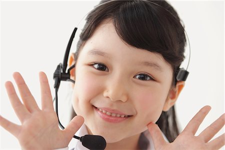 Happy Girl Wearing Headset Stock Photo - Rights-Managed, Code: 859-03806170