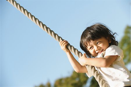 swing (sports) - Boy Holding Rope Stock Photo - Rights-Managed, Code: 859-03806208