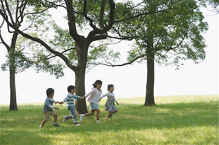 Children Playing In Park Together Stock Photo - Rights-Managed, Code: 859-03806228