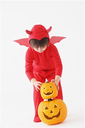 3 Year Boy Dressed Up As Devil with Pumpkins Stock Photo - Rights-Managed, Code: 859-03806256