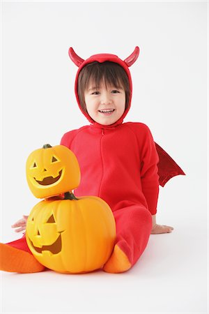 3 Year Boy Dressed Up As Devil with Pumpkins Stock Photo - Rights-Managed, Code: 859-03806258