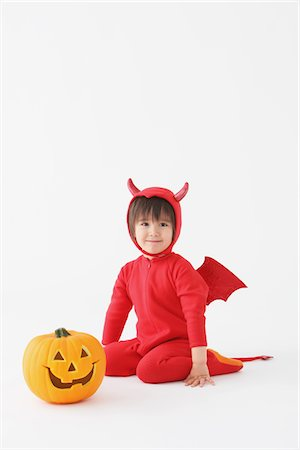 3 Year Boy Dressed Up As Devil with Pumpkins Stock Photo - Rights-Managed, Code: 859-03806259