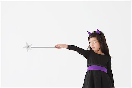 Girl Holding Magic Wand in Costume for Halloween Stock Photo - Rights-Managed, Code: 859-03806263
