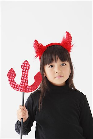 Girl Dressed In Halloween Costume as Devil Stock Photo - Rights-Managed, Code: 859-03806278