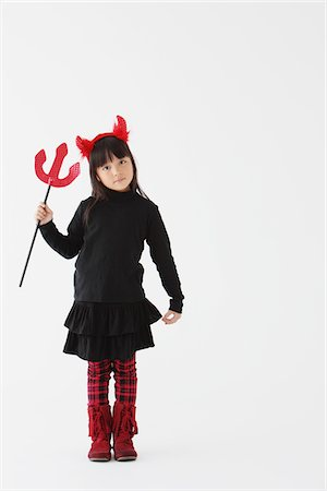 Girl Dressed In Halloween Costume as Devil Stock Photo - Rights-Managed, Code: 859-03806279