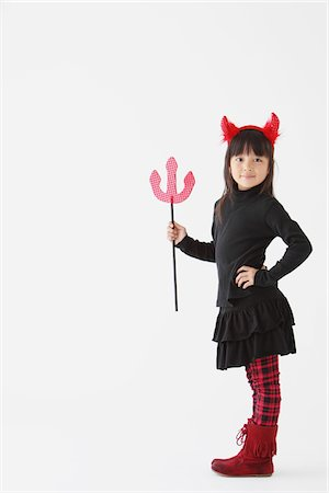 Girl Dressed In Halloween Costume as Devil Stock Photo - Rights-Managed, Code: 859-03806280