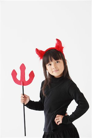 Girl Dressed In Halloween Costume as Devil Stock Photo - Rights-Managed, Code: 859-03806281