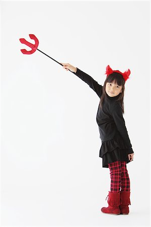 Girl Dressed In Halloween Devil Pointing With Trident Stock Photo - Rights-Managed, Code: 859-03806282