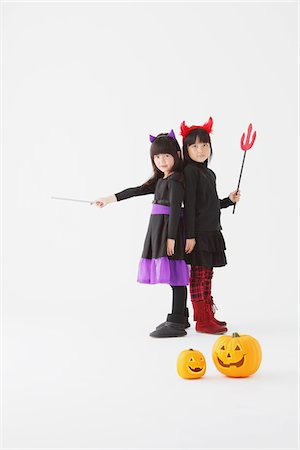 Two Girl Dressed In Halloween Costume Stock Photo - Rights-Managed, Code: 859-03806299