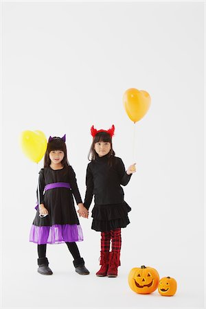 Two Girl Dressed In Halloween Costume Holding Balloons Stock Photo - Rights-Managed, Code: 859-03806305