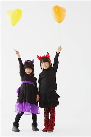 Two Girl Dressed In Halloween Costume Holding Balloons Stock Photo - Rights-Managed, Code: 859-03806306