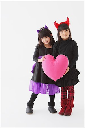 Two Girls In Halloween Costume Holding Heart Stock Photo - Rights-Managed, Code: 859-03806307