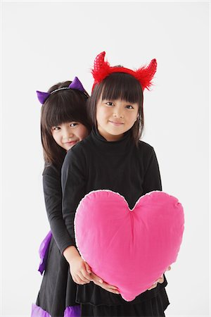 Two Girls In Halloween Costume Holding Heart Stock Photo - Rights-Managed, Code: 859-03806308