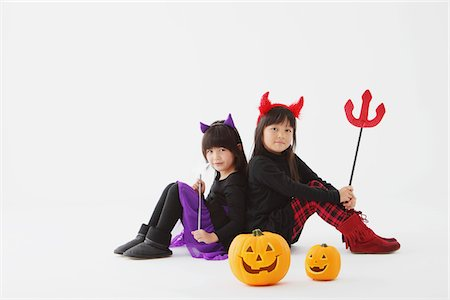 Two Girl Dressed In Halloween Costume Back To Back Stock Photo - Rights-Managed, Code: 859-03806302