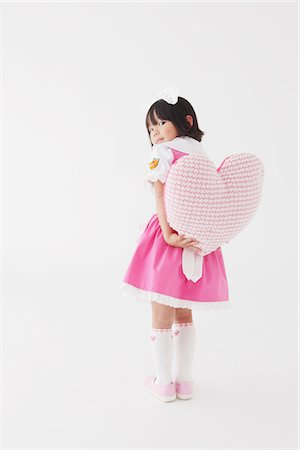 female silhouettes heart - Japanese Girl Holding Heart Stock Photo - Rights-Managed, Code: 859-03806333