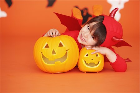 Boy Dressed Up As Devil against Orange Background Stock Photo - Rights-Managed, Code: 859-03806344