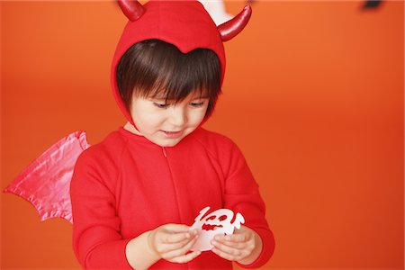 Boy Dressed Up As Devil against Holding Ghost Stock Photo - Rights-Managed, Code: 859-03806346
