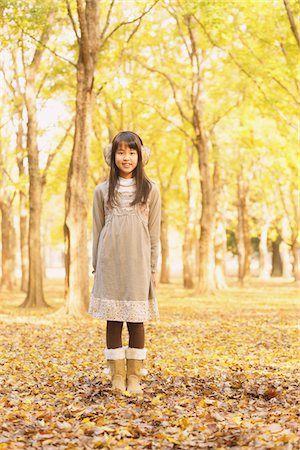 Girl Standing In Park In Autumn Stock Photo - Rights-Managed, Code: 859-03839325