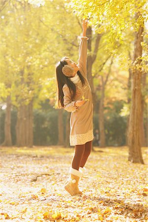 preteen touch - Girl Trying To Reach For Leaves On A Tree Stock Photo - Rights-Managed, Code: 859-03839348