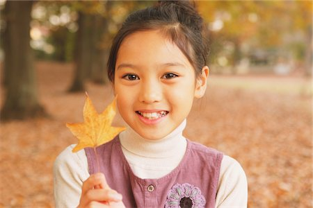 Preteen Girl Holding Maple Leaf Stock Photo - Rights-Managed, Code: 859-03839422